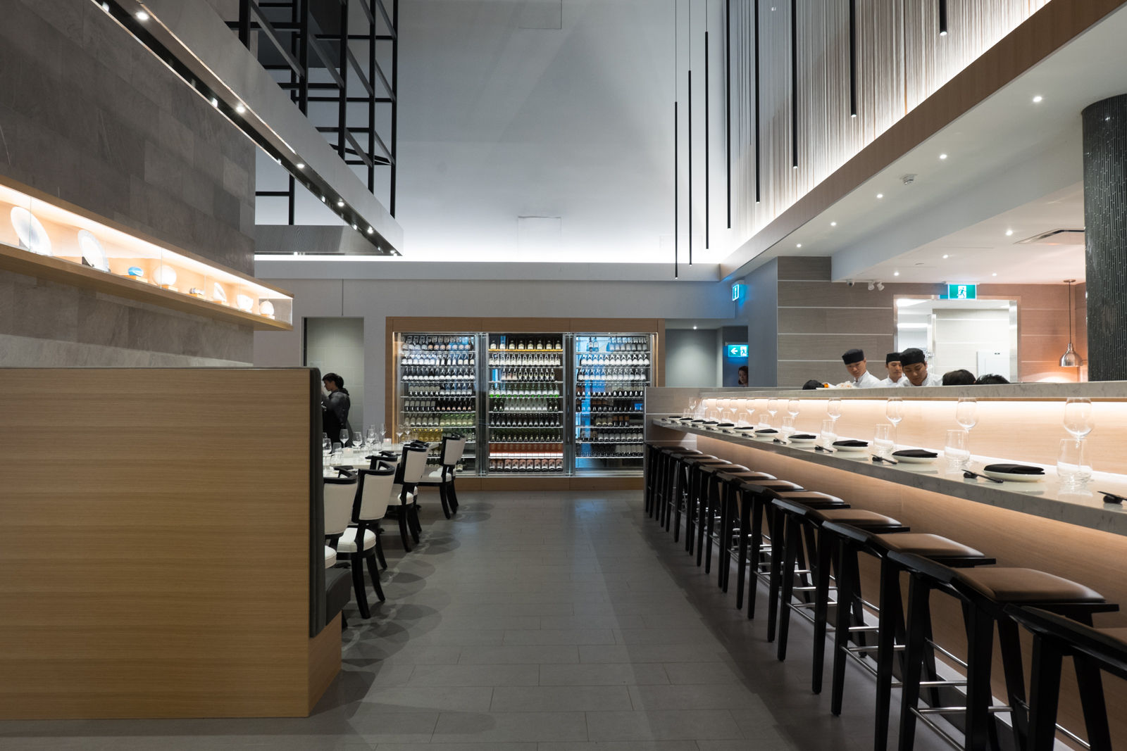 Custom refrigerated wine cooler and Sushi Bar with Seating.